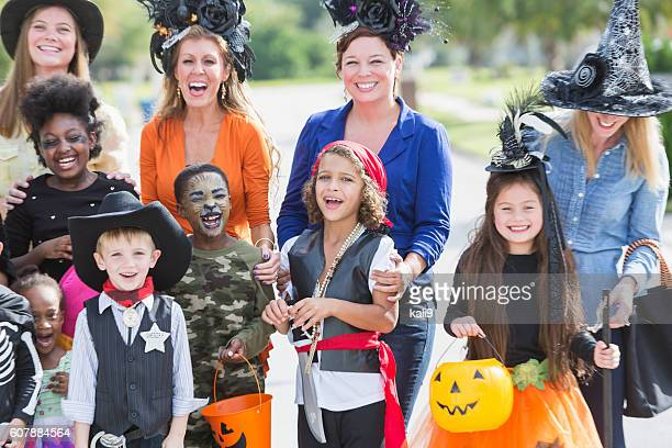 Group of children and mothers on Halloween