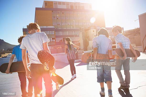 Group of children (8 - 10 years) at sunset