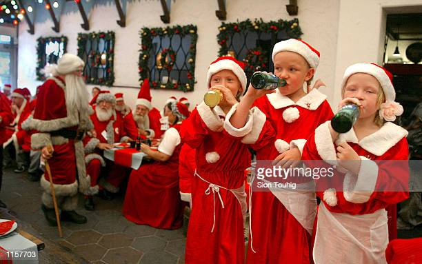 A group of children dressed as Santa's Helpers attend the 39th World Santa Claus Congress July 24 2002 in Copenhagen Denmark There are more than 120...