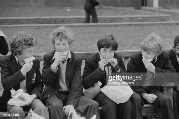 A group of children eat lunch outside 14th March 1978