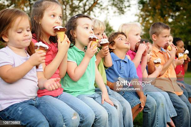 Group of Children Eating Ice Cream Cones Outside