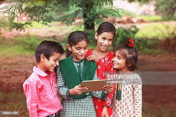 Group of children enjoying digital tablet