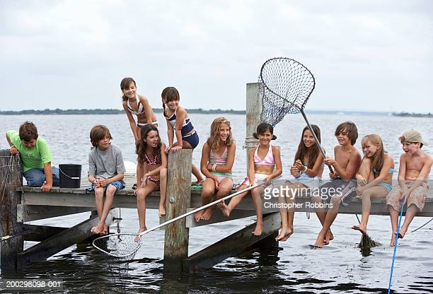 Group of children (5-12) fishing on jetty (Digital Composite)