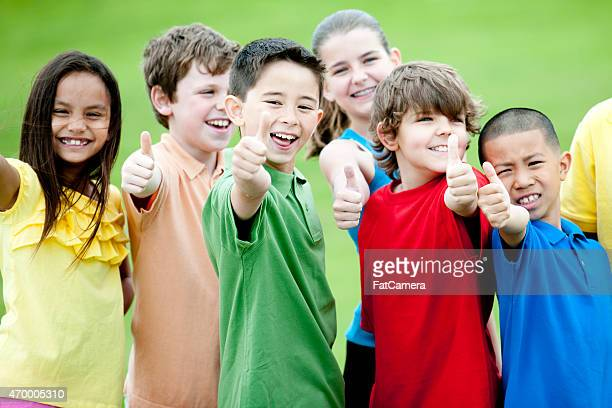 Group of Children giving Thumbs Up