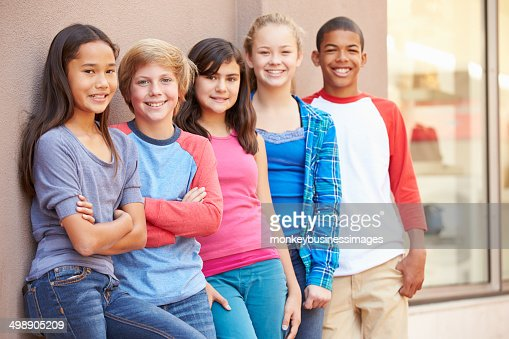 Group Of Children Hanging Out Together In Mall : Stock Photo