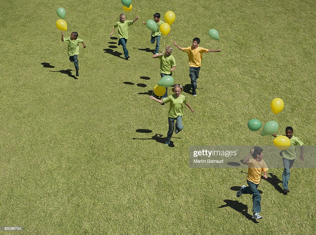 Group of children holding balloons : Stock Photo