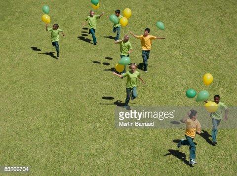 Group of children holding balloons : Stock Photo