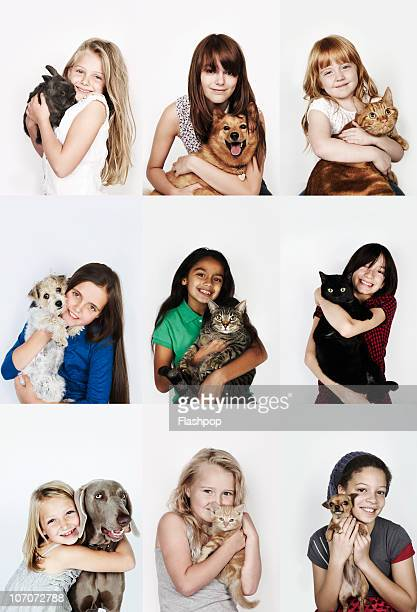 Group of children hugging their pets