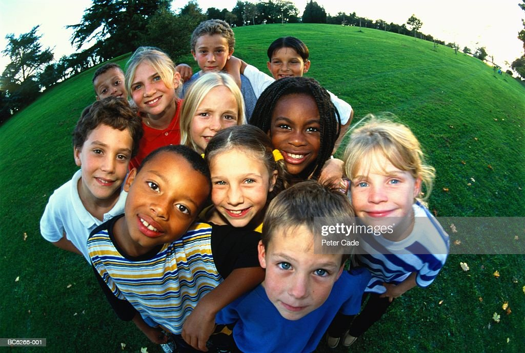 Group of children (8-11) in park, portrait, elevated (wide angle) : Stock Photo