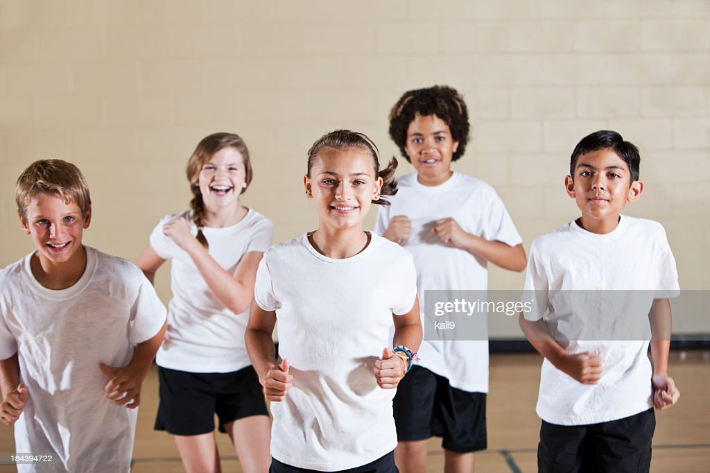 Group of children in phys ed class exercising