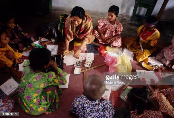 A group of children in the class of a non formal primary school setup by CONCERN in Bangladesh Education is fundamental to the development of...