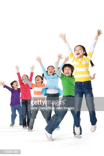 A group of children jumping up with excitement : Stock Photo