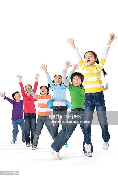A group of children jumping up with excitement