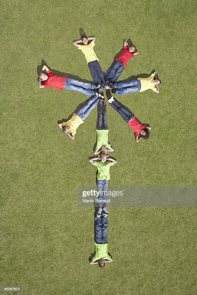 Group of children laying in flower formation : Stock Photo
