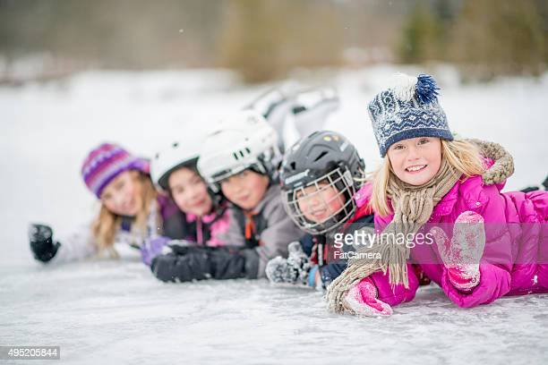 Group of Children Lying on a Frozen Lake