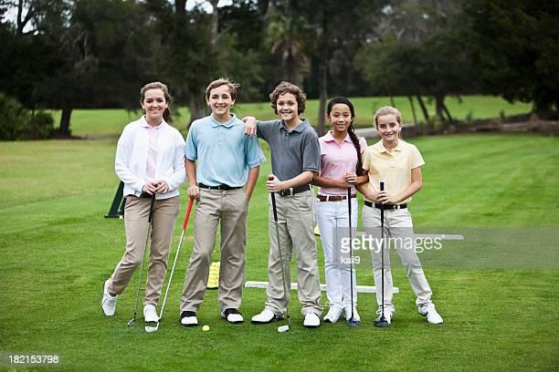 Group of children on golf driving range