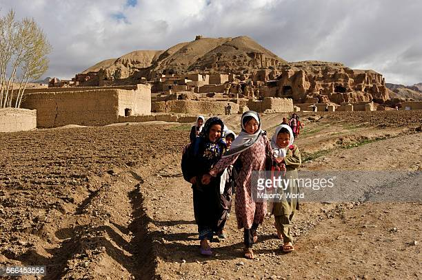 A group of children on their way to school from their village on the hills of Bamyan in Bamyan province Afghanistan May 11 2009