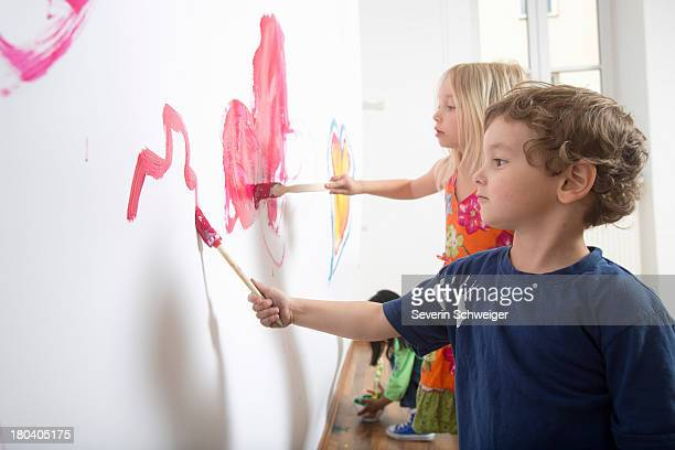 Group of children painting wall