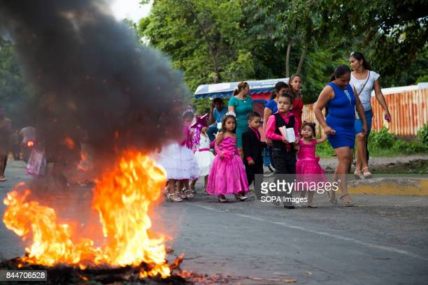 CHICHIGALPA CHINANDEGA NICARAGUA A group of children pass front of a burning barricade during clashes betwee locals people and police Demonstrations...