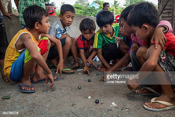 A group of children play with marbles on September 6 2014 in Tuol Sambo Cambodia Three different communities live on the outskirts of Phnom Penh in...