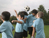 Group of children (7-9) playing football