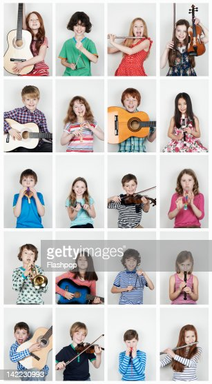 Group of children  playing musical instruments