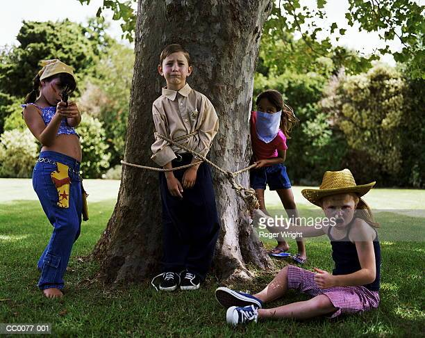 Group of children playing robbers and sheriffs