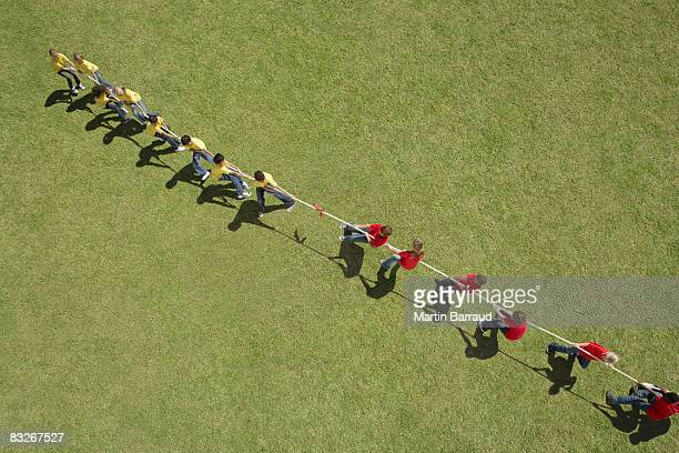 Group of children playing tug-of-war