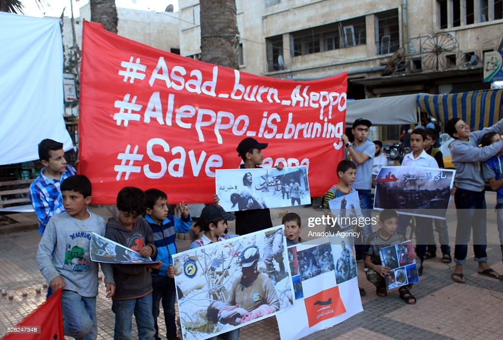 A group of children protestors hold sings to protest air strikes conducted by the Assad regime and Russia over the Aleppo in Idlib, Syria on May 4, 2016.