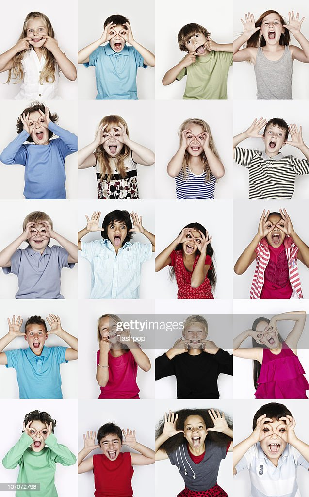 Group of children pulling funny faces : Stock Photo