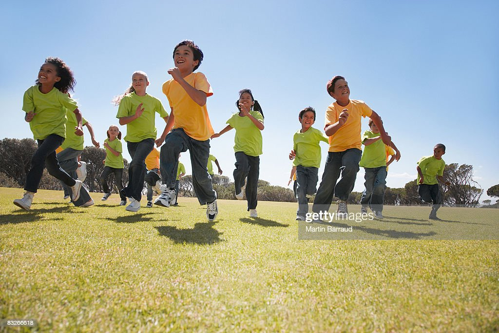 Group of children running in park : Stock Photo