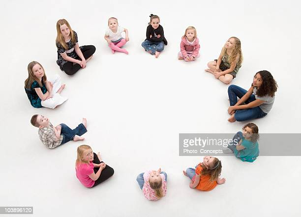 Group of children sitting in a circle.