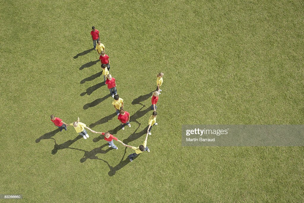 Group of children standing in arrow formation : Stock Photo