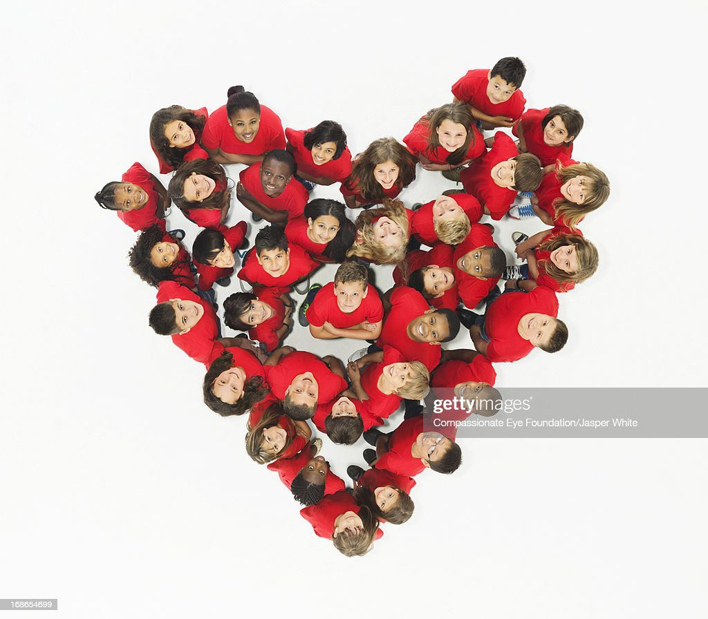Group of children standing in heart formation : Stock Photo