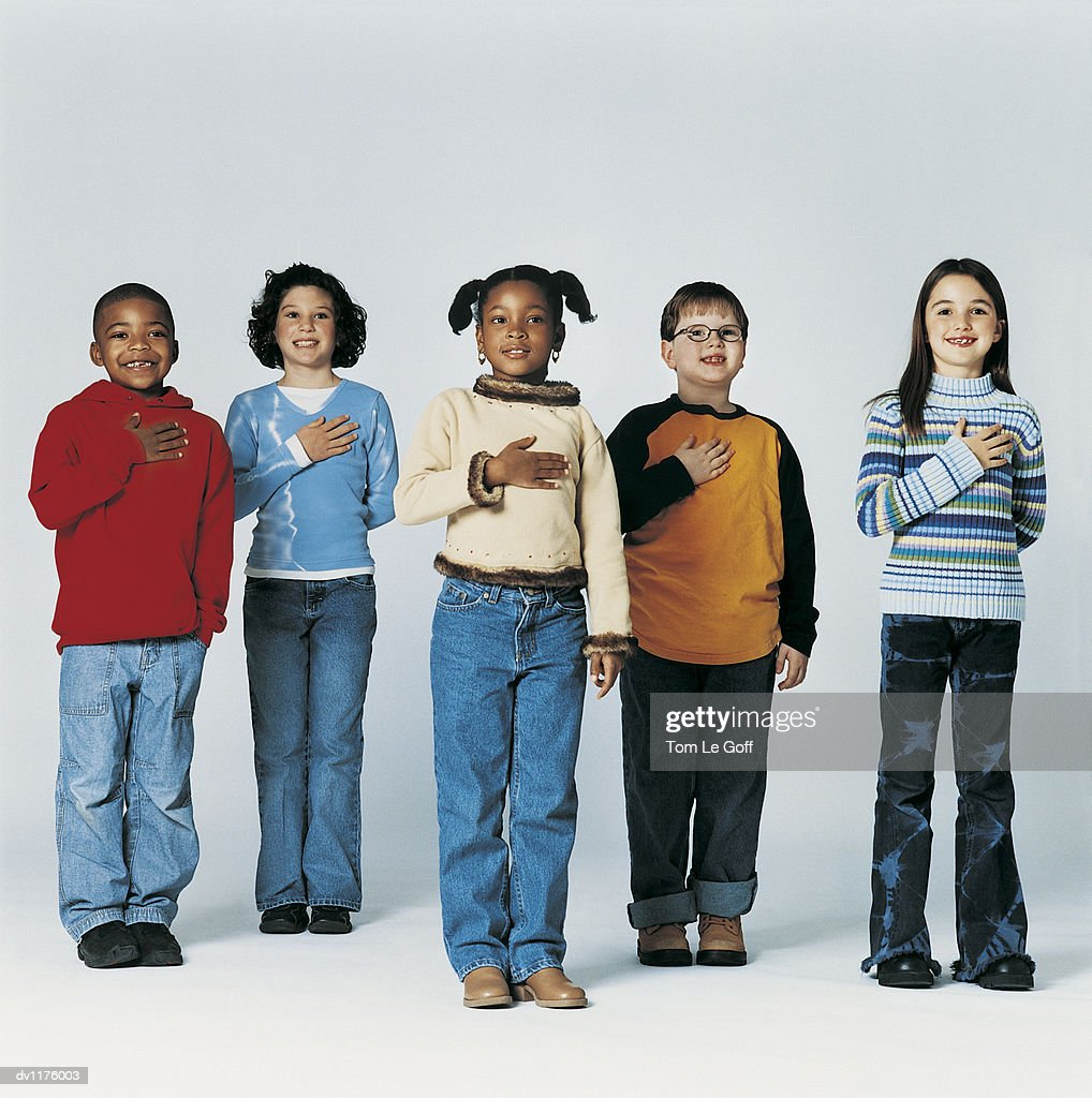 Group of Children Swearing a Pledge of Allegiance : Stock Photo