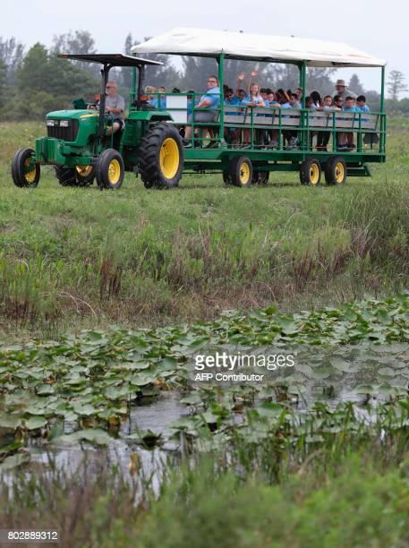 A group of children take a training tour through the Everglades at the Arthur R Marshall Loxahatchee National Wildlife Refugee in Boynton Beach...