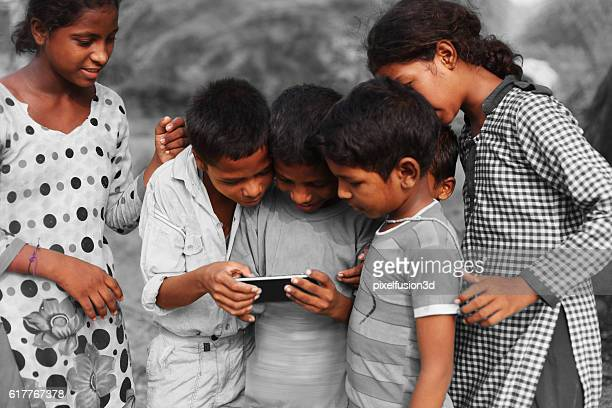 Group of children using smart phone