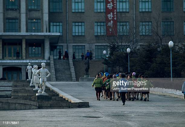 A group of children walking in line towards the Pyongyang Children's Palace Pyongyang North Korea February 1973