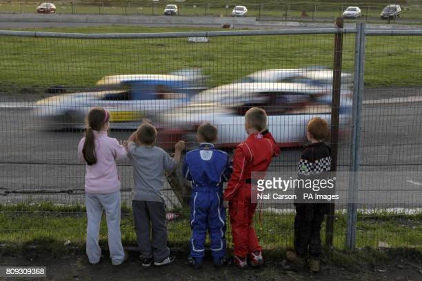 A group of children watch stock car racing event at Nutts Corner Oval in Crumlin Northern Ireland Picture date Saturday June 11th 2011