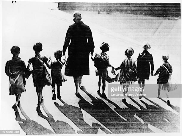 Group of Children with Emergency Packs on their Backs Being Mobilized for Possible Evacuation due to Pending War Crisis London England August 1939
