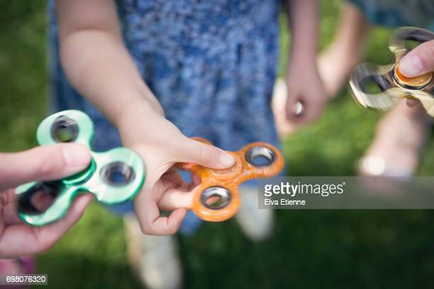 Group of children with fidget spinners