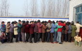 A group of Chinese farmers queue up at a local clinic in Wenlou village China's Henan province 21 February 2004 to get their supply of free AIDS...