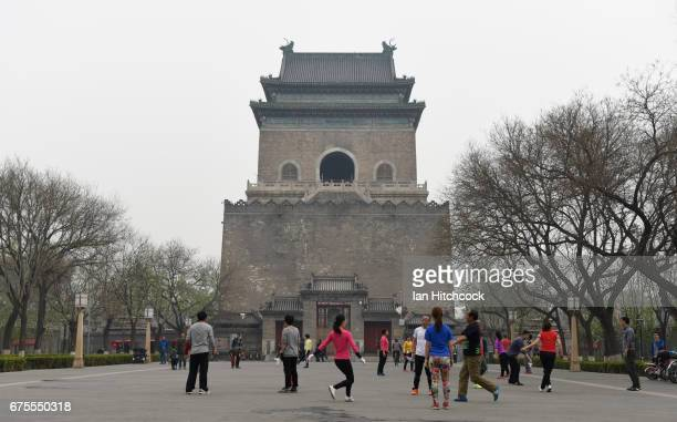 A group of Chinese locals play a form of kicking shuttlecock at the base of the Bell Tower on April 4 2017 in Beijing China