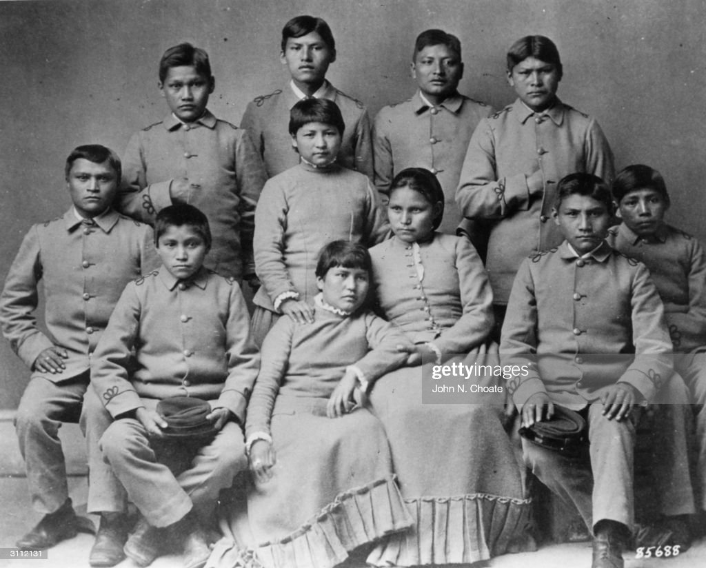 A group of Chiracahua Apaches after attending Carlisle Indian school for four months