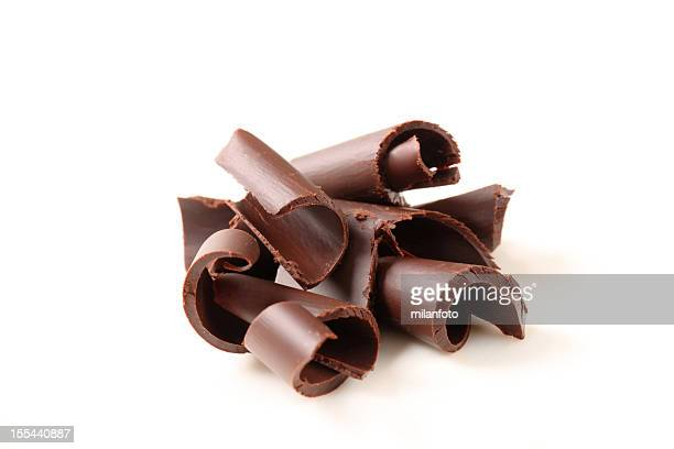 Group of chocolate curls on a white background