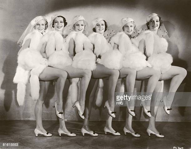 A group of chorus girls in costumes of white fur circa 1935