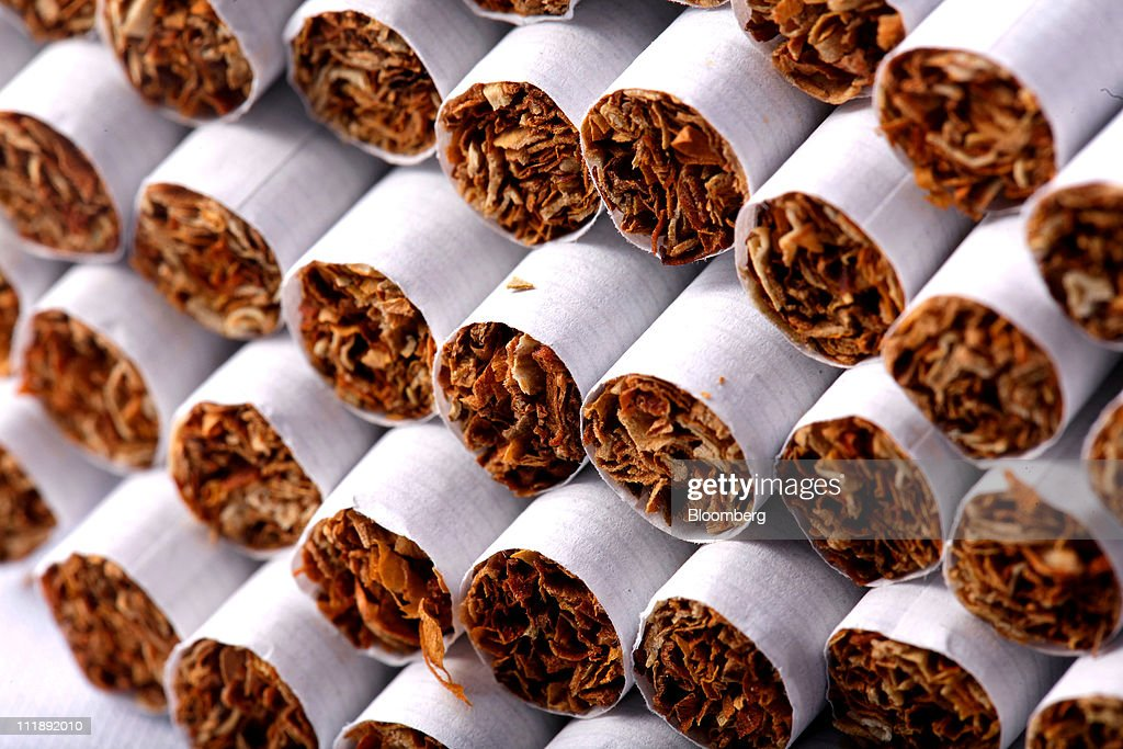 A group of cigarettes sit arranged for a photograph in London, U.K., on Thursday, April 7, 2011. The global market for cigarettes excluding China, which is largely closed to foreign tobacco companies, will probably shrink by 2.5 percent in 2011, BAT Chief Executive Officer Nicandro Durante said Feb. 24. Photographer: Jason Alden/Bloomberg via Getty Images