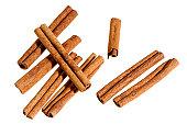 Group of cinnamon sticks on white background