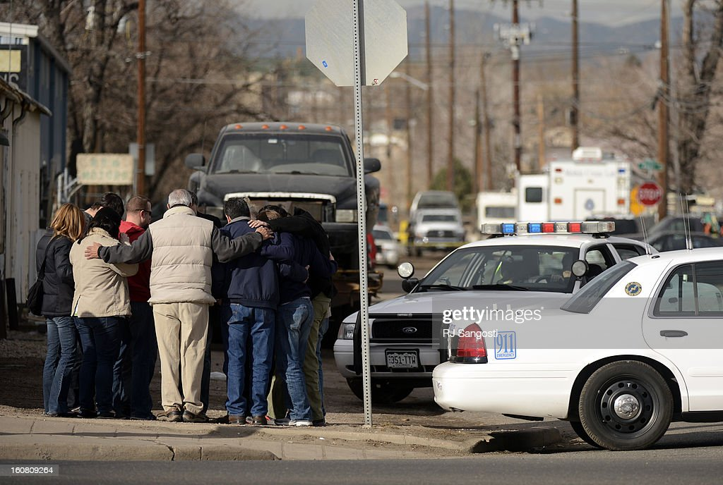 A group of citizens stop and pray near the scene of a shooting on the 4900 block of North Pearl Street in Denver, February, 06, 2013. Three people were found dead when police responded to the home in the area.