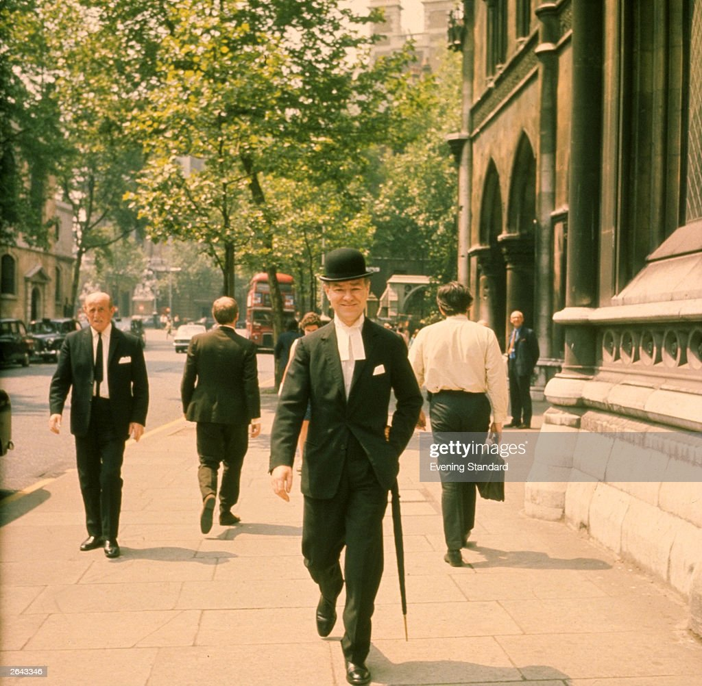 A group of city gents walking down a London street